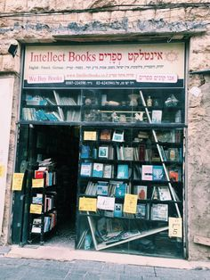 """aboutbookstores: """"literaryglamour: """" You know you have a reputation as a bibliophile when your mom sends you photos of bookstores during her trip to Israel """" Intellect Books - Jerusalem - Israel """""""
