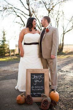 Gorgeous November fall autumn barn wedding close to Salem Oregon. Bride and groom thank you photo with pumpkins and pinecones