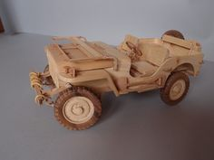 Wooden model of the famous Willys MB jeep in 1/12 The model is made entirely of wood, original built for down to the last detail It is equipped with some features everything from wood E.g. functional suspension, rotating and steering wheels! The dimensions are approx. 285mm L, 135mm W, 140mm H The species I have used are pine, walnut and pear wood, and beech and Birch plywood for the more stressed parts. The model is untreated and treated in any way, so one can still clearly perceive...
