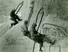 Mount Rushmore construction workers hanging by cables. Photo #31 by Charles D'Emery / NPS