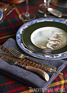 Charming Ralph Lauren salad plates, and antique stag-handled flatware from Asprey in London dress the table. - Photo: John Merkl / Design: Scot Meacham Wood