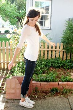 Cute and simple white shirt blue jean outfit. Great example of how to wear shoes with long capris. From Katie Did What