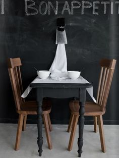 Great idea for a table - it could match our chalkboard wall.