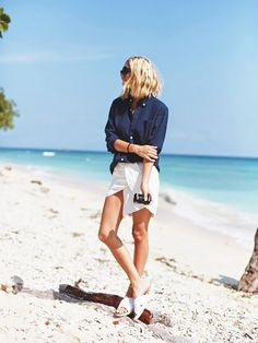 Try tucking your denim top into a summer mini skirt. // #StyleTip
