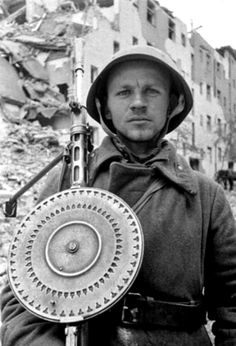 A portrait of a Soviet soldier carrying his Degtyaryov DP-28 light machine gun during the final days of the Battle of Berlin. Berlin, Germany. April 1945.