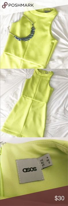 ASOS Neon Green Dress This gorgeous dress is perfect for summer! A fun lime green color, this piece is great to mix and match with pops of color in accessories! Mini dress length. EUC! Material/care tag cut out, but it's a shiny, thick, stretchy material. ASOS Dresses Mini
