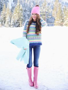 Pink rain boots with jeans and a matching sweater