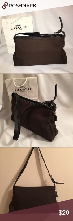 "Authentic Brown leather and fabric bag Authentic Coach brown fabric and black leather shoulder bag E9J-7406  with leather strap and bottom.Clean inside and out . See pics for fading leather on zipper part and strap near buckle. Great Bag. 13"" across 7"" height 3"" depth 12"" drop Coach Bags Shoulder Bags"