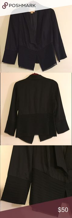 Black Blazer by Anthropologie Great classic blazer, with a feminine flare. Lovely subtle layers of tulle fall along the bottom 6 inches of the body and sleeves. Very lightly worn. This is a true 6 - it's a little large on me, and I tend to be a 2-4 on the top. Brand is Fleur Wood. Jacket is tencel, with a beautiful subtley patterned polyester lining. Anthropologie Jackets & Coats Blazers