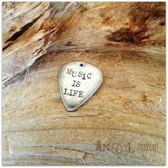 ~Music Is Life~  Upcycled vintage silver spoon guitar pick. Hand cut, shaped and stamped by me in America~    This pick was hand cut from a 1916 era