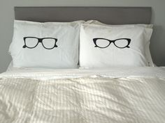 His and Hers Pillows.  My DIY take would be to cut these out in felt and sew them on to some shams. :)