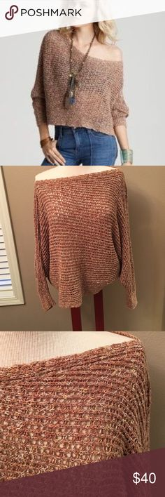 "New Listing! Free People Sunday Smile Free people Sunday smile pullover sweater. Beautiful camel colored open Knit slouchy pull over sweater asymmetrical hemline. Dolman sleeves. Cotton/acrylic/polyester. Size small-excellent condition! Appx- 17"" across chest and 22"" long. Free People Sweaters"