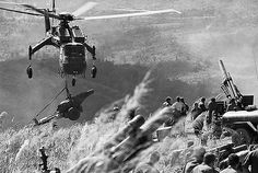 02 Jan 1969, Dong Ha, South Vietnam --- Special Delivery. Dong Ha, South Vietnam: A helicopter drops another howitzer for a contingent of the U.S. 3rd Marine Division that is occupying a high area near the Laotian border. Some 5,000 U.S. and South Vietnamese troops massed to stage a drive against an area near the abandoned allied fortress at Khe Sanh in a search for North Vietnamese regulars and the equipment. --- Image by © Bettmann/CORBIS
