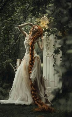 Red hair ginger rapunzel fantasy art fashion editorial photography girl female upper body haute couture luxury high fashion portrait woman in dress in a  baroque garden, color photo, fashion face portrait picture