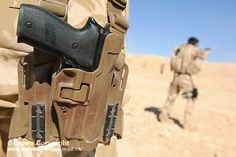A British Army issue Sig Sauer pistol carried by a soldier on a firing range in the Jordanian desert. Sig Sauer 9mm, 9mm Pistol, Tactical Gear, Tactical Supply, Tactical Holster, Tac Gear, Cool Guns, Guns And Ammo, Special Forces