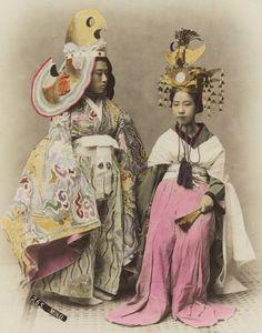 """Miko - Japanese shrine maiden."" Hand-colored photo, 1880's, Japan. Photographer: Kusakabe Kimbei"