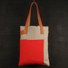 ,red square in the corner tote bag