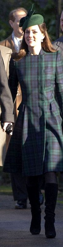 Kate Middleton wore a tartan Alexander McQueen dress as the Royal Family gathered at the Queen's Sandringham Estate for a traditional Christmas Day church service 2013.
