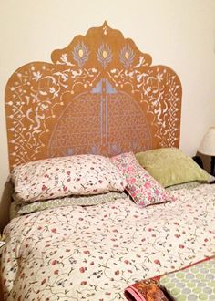Sylvie Bilger from Metamorfaux stenciled a canvas headboard with the help of our Peacock Fancy stencil.