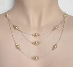 http://beabijoux.free.fr/wp-content/uploads/2011/01/60-Collier-mariage-ivoire.jpg