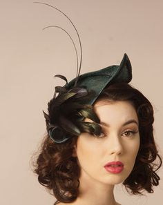 Judy Bentinck Mantalini Jade Parisisal Headpiece with natural coque feathers and black quills.