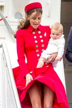 April 7, 2014 - Princess Kate coming down the aircraft steps landing in New Zealand with her husband Prince William and little Prince George.