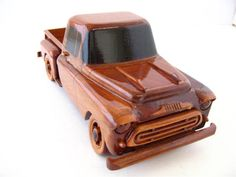 Bring back memories of cruising Main, stopping by the local drive-in and late night pranks with this handcrafted 1957 Chevy Truck. A deep wood grain is enhanced by hand carved details and multiple coats of polyurethane finish. All Toys, Toys For Boys, Kids Toys, Wooden Toy Trucks, Wooden Car, 57 Chevy Trucks, Trucks Only, Wooden Gifts, Woodworking Workshop