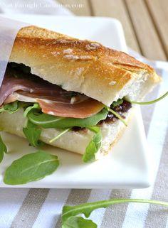 Prosciutto sandwich with fig, pesto and arugula