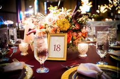 Michael Bambino Co Photography Viva Bella Events Courtenay Lambert Florals Courtenay Lambert Event Design Bell Event Center Bell Event Centre Cincinnati Wedding Florist Cincinnati Wedding Flowers Fall Autumn Purple Orange Table Scape Reception Table Numbers Centerpeice