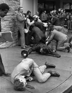 March 30, 1981 — Assassination attempt on President Reagan. Secret Service agent Timothy J. McCarthy, Washington police officer Thomas K. Delahanty, and presidential press secretary James Brady lie wounded on the street after shots were fired at President Reagan on March 30, 1981. McCarthy threw himself into the line of fire after gunman John Hinckley Jr. had fired six shots from a crowd.: