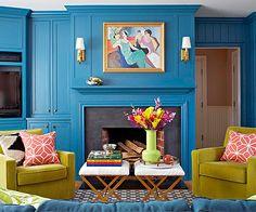 Bold Blue Walls with a Tarkay knockoff painting !! The pea green chairs definitely pop, a little too much for me !
