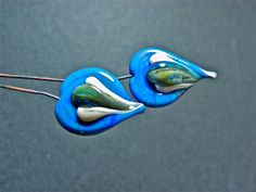 Two handmade glass headpins by FireForgedStudio on Etsy, $9.00