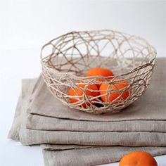 Learn how to make this stunning, sculptural string bowl with just a few simple supplies. Easy step-by-step tutorial with full photography.