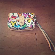Disney Dooney & Bourke Wristlet One of Disney's retired Dooney & Bourke patterns! One of the original patterns they introduced. Used once, like new. Great condition. Has one slide pocket on the back. Happy shopping! Dooney & Bourke Bags Clutches & Wristlets