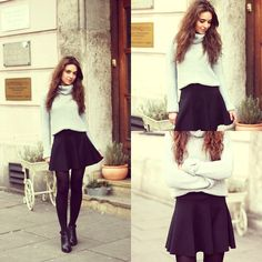 Skater skirt with baggy sweater. Tights and boots.
