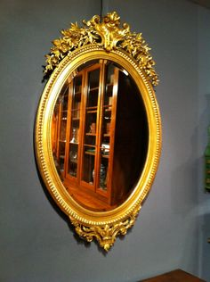 Beautiful #oval mirror with pediment #LouisXVI #style. #Gold leaf gilding and original beveled glass. NapoleonIII period. For sale on #Proantic by Serignan Antiquités.