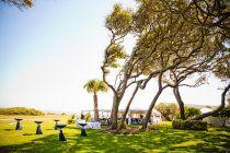 Style Me Pretty | GalleryWedding reception site next to beach under a white tent on Jekyll Island. Beachview Club Hotel.