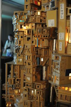 """Abandoned Housing Estate Number N"" is a unique miniature city, made entirely from corrugated cardboard."