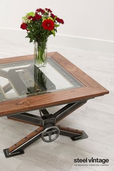 Handmade steampunk theme coffee table with walnut trim and glass top.