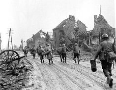 The 121st US Army Infantry Division marching through Hürtgen during Thanksgiving 1944.    An order was passed by command that EVERY man in the field should have a Thanksgiving meal…unknown to command was the fact that the Germans had their positions zeroed in with their artillery. Soon as the men received their food the Germans opened up and many many US Soldiers died.