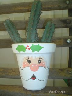 Santa Claus flower pot has a water proof varnish inside and out.