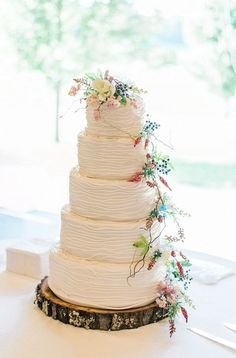 Elegant rustic chic five-tier round wedding cake with colorful wildflowers {Michelle Lea Photographie}