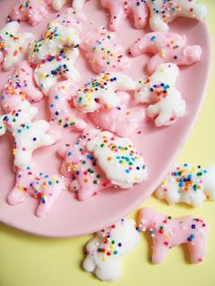 animal cookies with sprinkles - Did these for Sammy's school lunches and Eva's 1st birthday party. They are easy and turned out just like the photo. So good! I don't know where the link went, but I just used Wilton candy melts (light pink) and Sammy sprinkled with little tiny sprinkles. Adorable.