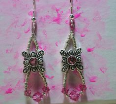 https://flic.kr/p/5cNDzf | Pinky earrings | swarovskis sparkling for Relay for Life 2008. sold. woo-hoo!