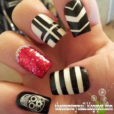 Perhaps the cross design and the other nails be solid black with shiny red nail?