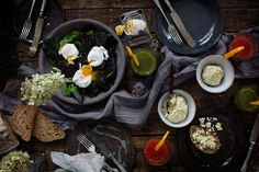 On the table. Food photography. Creative. Flower. Eggs and bread. Juice. Composition. Photo by Pia Inberg.
