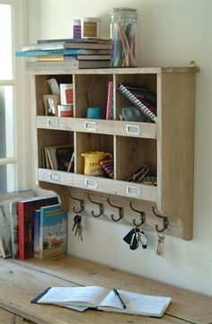 Wooden Cubby Hole Unit with Hooks providing 6 spacious cubby holes and 5 equally useful hanging hooks.