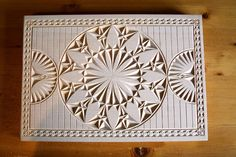 Apparently chip carving is a thing. And this at least looks quite nice.