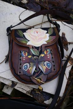 SkyRavenWolf.com : £56,  little bag with beautifully detailed pink rose and peacock butterfly.