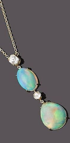 An opal and diamond necklace The old brilliant-cut diamond, suspending two oval-shaped opals and a similarly cut diamond highlight, diamonds approx. 0.50ct. total, length 45.2cm.